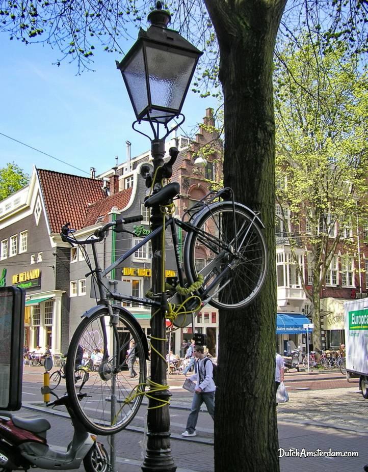 bicycle tied to streetlight